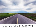 a straight road leading into...   Shutterstock . vector #1166912329