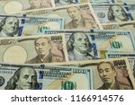 background with us currency and ... | Shutterstock . vector #1166914576