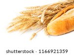 loaf of bread with ear of weat... | Shutterstock . vector #1166921359