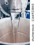 raw liquid silicon being poured ... | Shutterstock . vector #1166923843