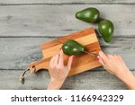 tabletop view  woman hands... | Shutterstock . vector #1166942329