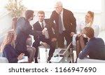 business partners shake hands... | Shutterstock . vector #1166947690