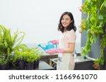 beautiful asian woman gardener... | Shutterstock . vector #1166961070