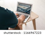 man using laptop to pay... | Shutterstock . vector #1166967223