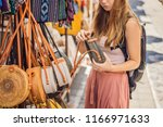 shopping on bali. young woman... | Shutterstock . vector #1166971633