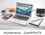 laptop with open page for... | Shutterstock . vector #1166991676