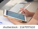 student doing exercise on... | Shutterstock . vector #1167057610