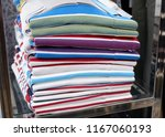folding clothes on the floor.   Shutterstock . vector #1167060193