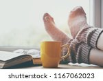 woman resting keeping legs in... | Shutterstock . vector #1167062023