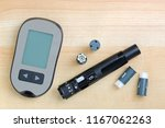 Blood glucose meter with finger ...