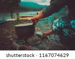camp and cooking in field... | Shutterstock . vector #1167074629