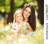 mother and daughter in the park | Shutterstock . vector #116708629