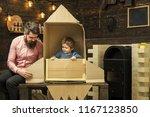 kid happy sit in cardboard hand ...   Shutterstock . vector #1167123850