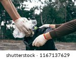 human hand picking up empty of... | Shutterstock . vector #1167137629