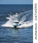 a fishing boat heads into... | Shutterstock . vector #1167143593