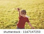 Happy Kid In Pilot Helmet...