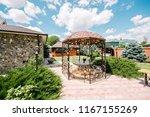 green garden near the cottage | Shutterstock . vector #1167155269