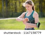 sport girl checking workout on... | Shutterstock . vector #1167158779