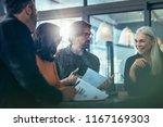 smiling mature business woman... | Shutterstock . vector #1167169303