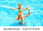 happy father with daughter... | Shutterstock . vector #1167172153