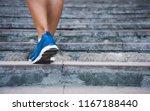 fitness woman running up the...   Shutterstock . vector #1167188440