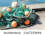 a fishing net with floats on a...   Shutterstock . vector #1167253696