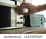 hand tuning vintage radio with... | Shutterstock . vector #1167299329