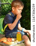 schoolboy eating outdoors the... | Shutterstock . vector #1167306259