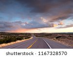 highway curving into the... | Shutterstock . vector #1167328570