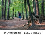 a man with red hat is standing... | Shutterstock . vector #1167340693