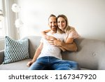 young couple on the sofa... | Shutterstock . vector #1167347920