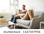 couple watching tv at home... | Shutterstock . vector #1167347956