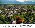 female tourist admiring view of ... | Shutterstock . vector #1167350506