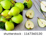 fresh juicy pears in a bowl.... | Shutterstock . vector #1167360130