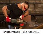 handsome male worker  wearing... | Shutterstock . vector #1167363913