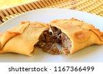 beef filled empanada or... | Shutterstock . vector #1167366499