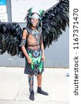 London, United Kingdom, August 27th 2018:- A young  participant about to take part in the Nottinghill Carival in west London, Europe's largest street party. - stock photo