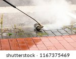 weed control with a weed lance... | Shutterstock . vector #1167375469
