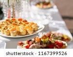 solemn banquet. lot of glasses... | Shutterstock . vector #1167399526