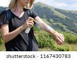 woman hiker applying sunscreen... | Shutterstock . vector #1167430783