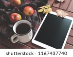 tablet hot tea checkered... | Shutterstock . vector #1167437740