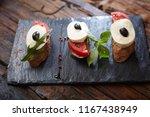 italian bruschetta with chopped ... | Shutterstock . vector #1167438949