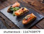 the tasty bruschetta with... | Shutterstock . vector #1167438979