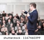 successful businessman holds... | Shutterstock . vector #1167460399