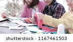 group of designers discussing... | Shutterstock . vector #1167461503