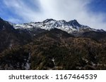 mountain scenery on the road... | Shutterstock . vector #1167464539