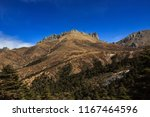 mountain scenery on the road... | Shutterstock . vector #1167464596