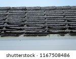 damaged black roof shingles   Shutterstock . vector #1167508486