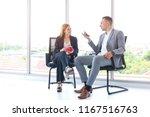 a business man sitting on chair ... | Shutterstock . vector #1167516763