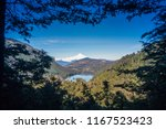 tinquilco lake and villarica... | Shutterstock . vector #1167523423